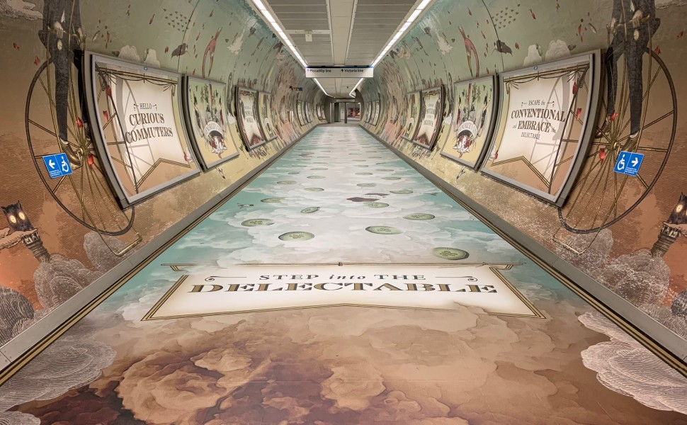 St Pancras tube station tunnel with Hendricks scented print graphics