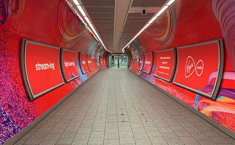 Virgin Media graphics inside a tunnel in London King's Cross Station